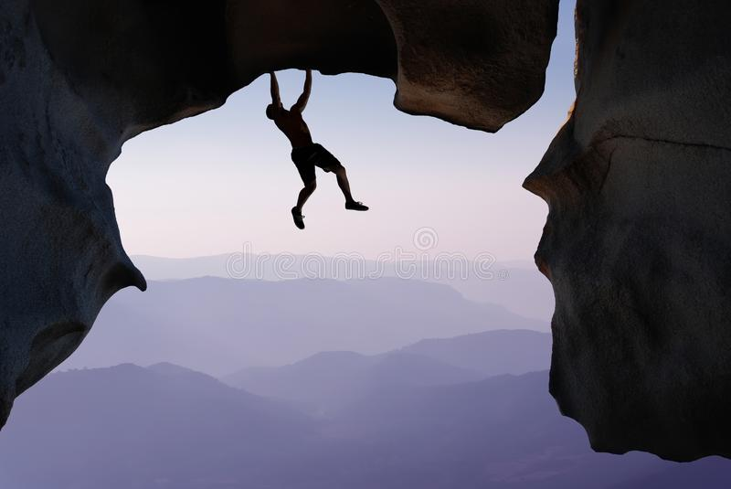 Rock Climber Extreme sports and Mountain climbing concepts. Man rock climber silhouette concepts of Courage and Adventure stock photography