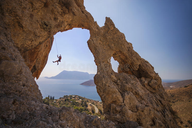 Rock climber falling of a cliff while lead climbing. royalty free stock photography