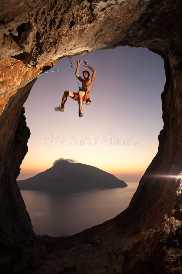 Rock climber falling a cliff while lead climbing stock photography