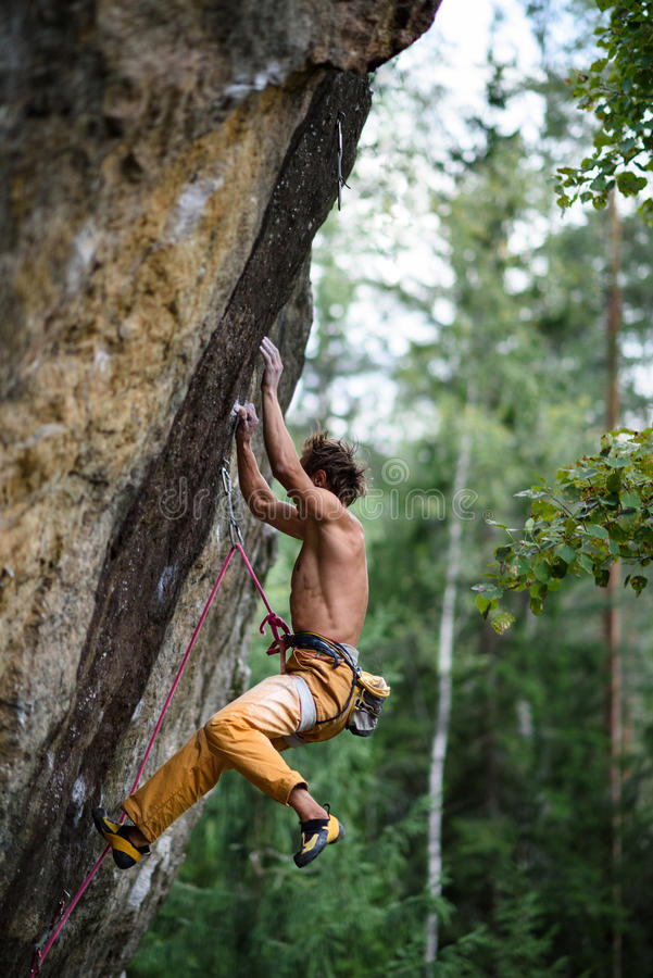 Rock climber falling down while ascending an overhanging. Extreme sport climbing. royalty free stock photos
