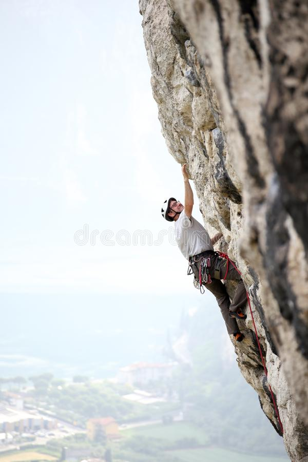 Rock climber is going up. On a rock wall royalty free stock photos
