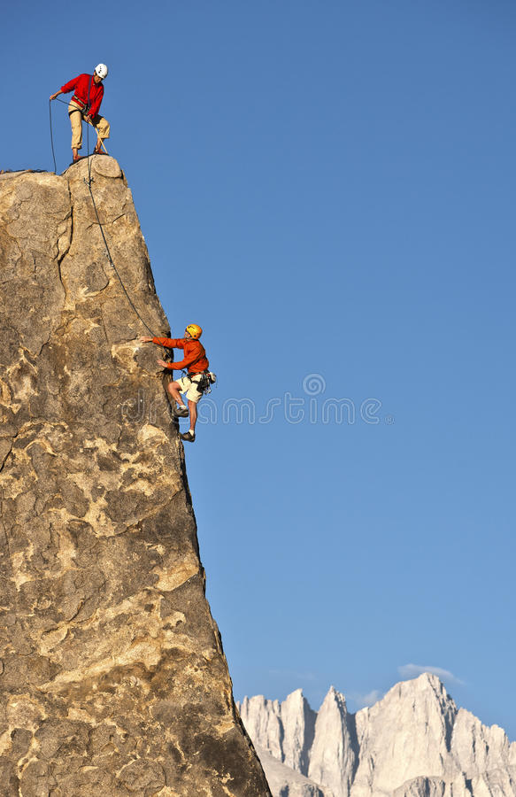 Rock climber rappelling. royalty free stock photo