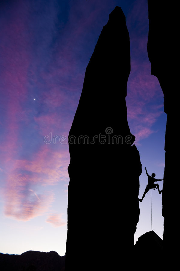 Download Rock Climber Reaching Across A Gap. Stock Photo - Image: 7725682