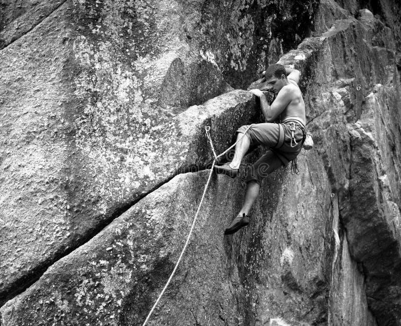 Rock climber on rock face royalty free stock photos