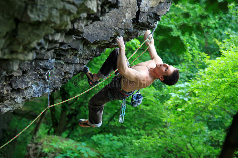 Download Rock climber on route stock image. Image of foliage, grip - 18117001