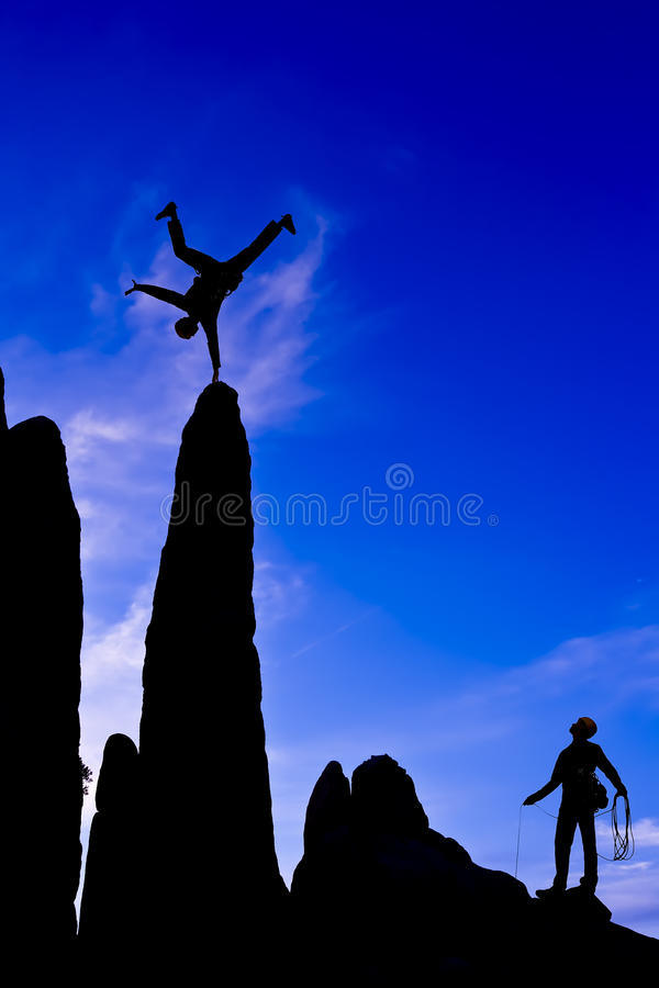 Rock climber on the summit. stock images
