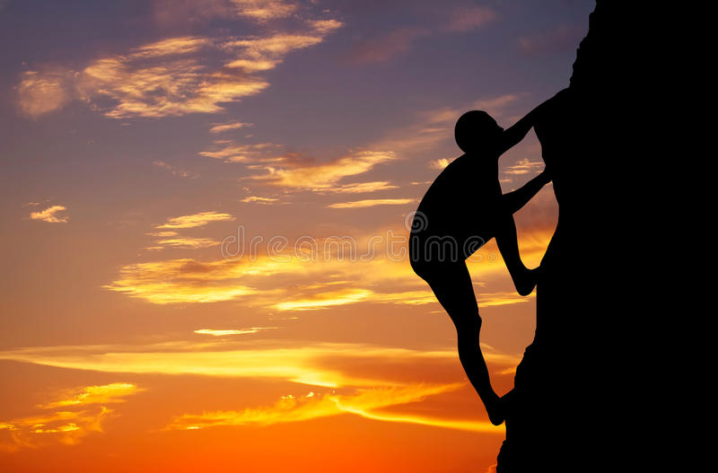 Rock climber at sunset background. royalty free stock images