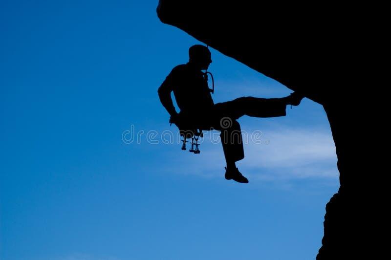 Rock climbing 008. Rock climber climbing with a rope stock image
