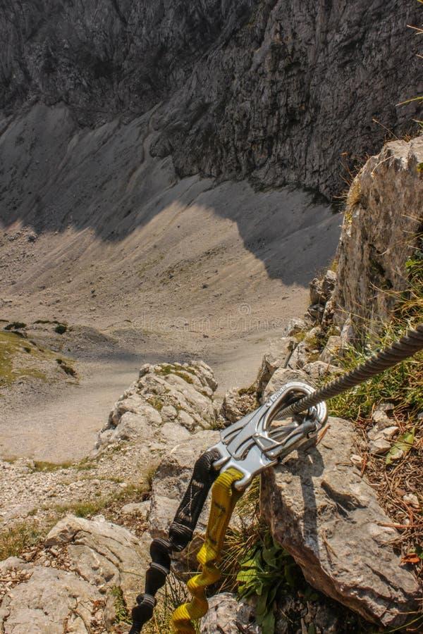 Rock climbing harness - high adrenalin in mountains - Austria. Rock climbing in high mountains, Climbing gera and harness. Adrenalin sport. European countrye stock photo