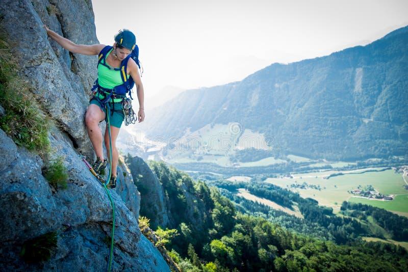 Rock climbing in the nature. Young woman enjoying rock climbing stock image