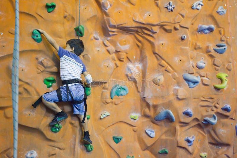 Rock-climbing teenager stock photo