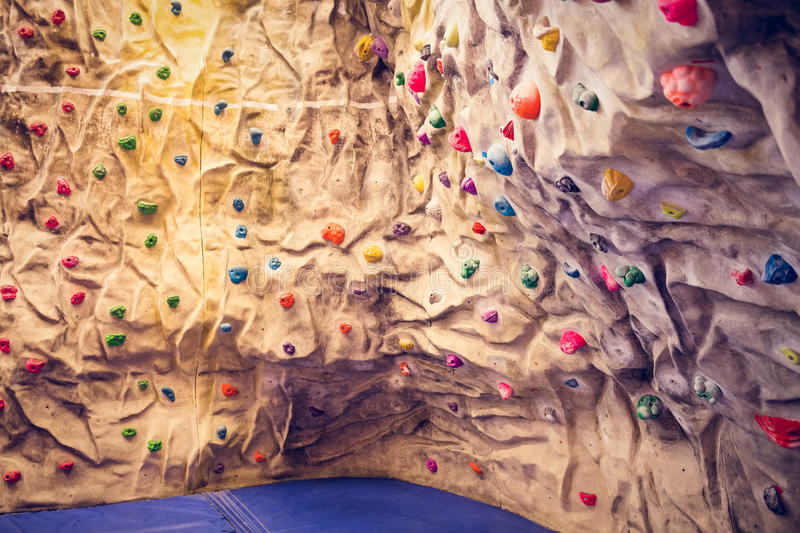 Rock climbing wall. At the gym stock images