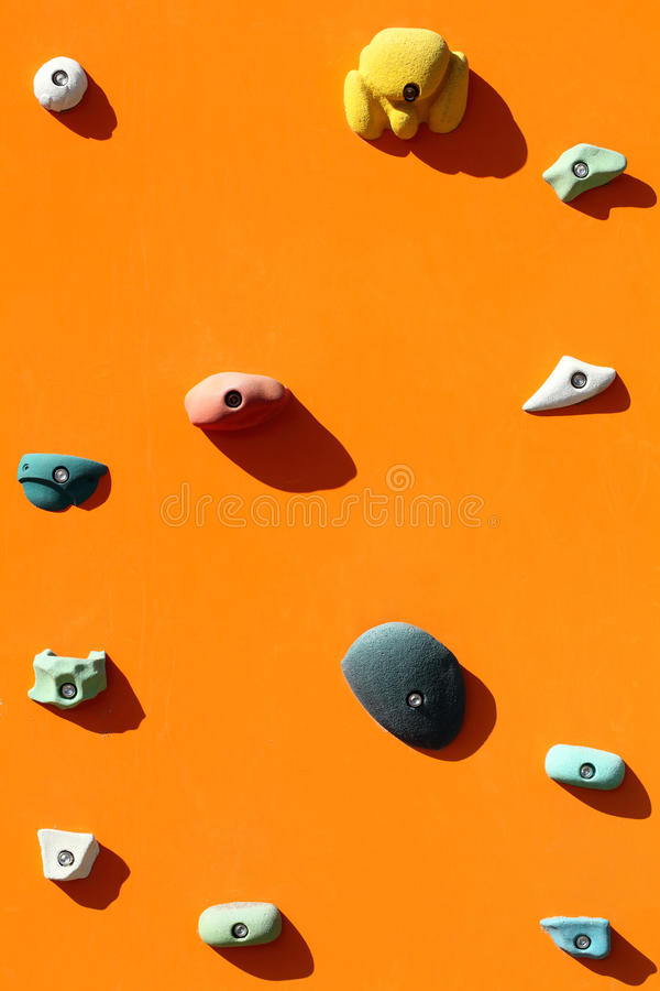 Rock climbing wall. With toe and hand hold studs stock images
