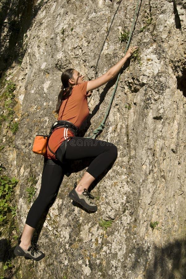 rock climbing woman stock photography