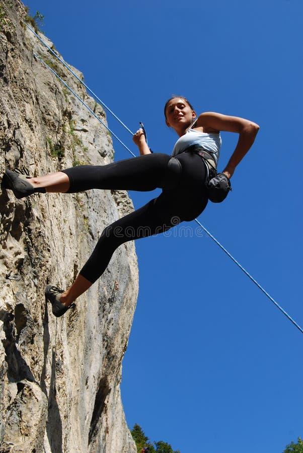 Rock climbing woman stock photo