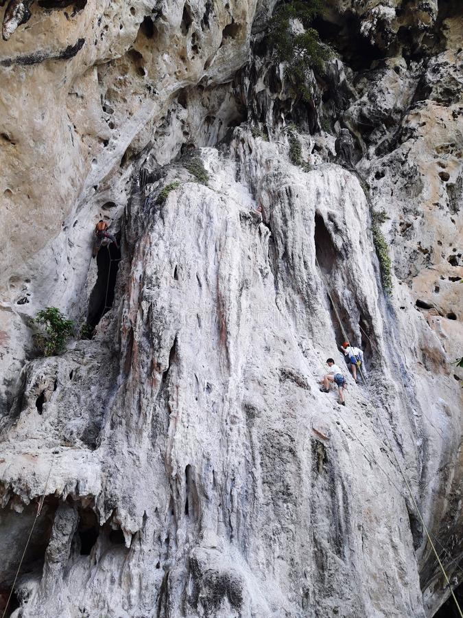 Rock climbing in World-famous Railay beach Thailand. Rock climbing world-famous railay beach thailand travel stock photo