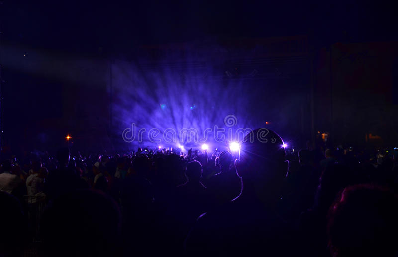 Rock concert. People having fun at a rock concert during night royalty free stock images