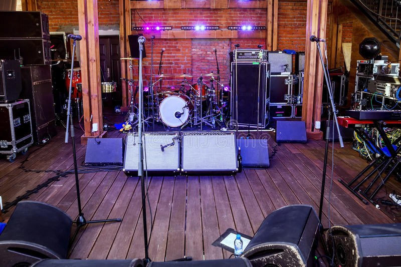 Rock concert stage. With musical instruments in nightclub stock photos