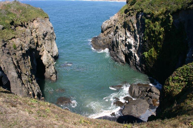 Rock cove on coast. Rock cove, nesting place for sea birds, on Oregon Coast royalty free stock photography