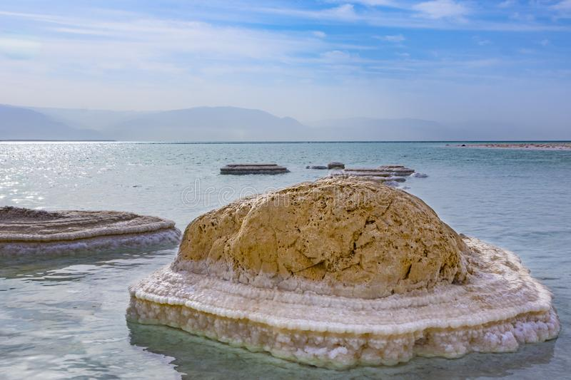 A rock covered in salt deposits at the dead sea, israel. royalty free stock photos