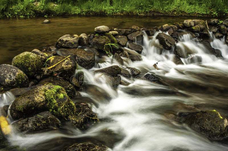 Download Rock Dam stock photo. Image of stream, water, green, river - 32451980