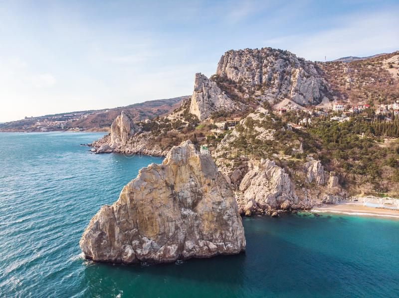 Rock Diva on beach, beautiful black sea shore landscape with mountain cliff, main nature landmark in Crimean Simeiz. Village resort for vacation, aerial view stock image