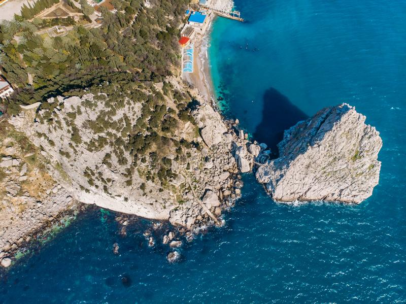 Rock Diva on beach, beautiful black sea shore landscape with mountain cliff, main nature landmark in Crimean Simeiz. Village resort for vacation, aerial top stock image