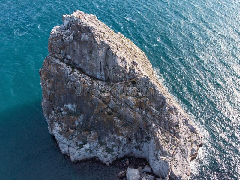 Rock Diva in Simeiz, Crimea, aerial top view of mountain cliff in sea, drone shot. Travel destinations. Concept royalty free stock photography