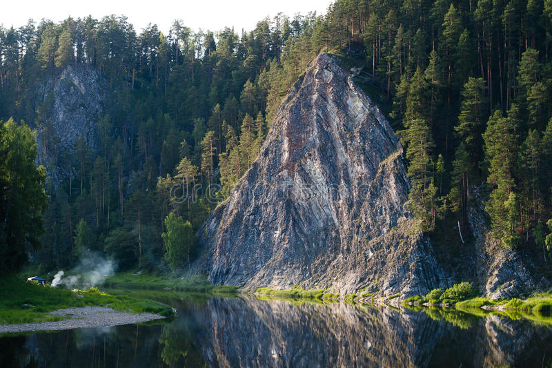 Rock Duzhnoy on the river Chusovaya, Perm region, Russia. Beautiful rock Duzhnoy on the river Chusovaya, landscape monument of nature, Perm region, Russia royalty free stock photography