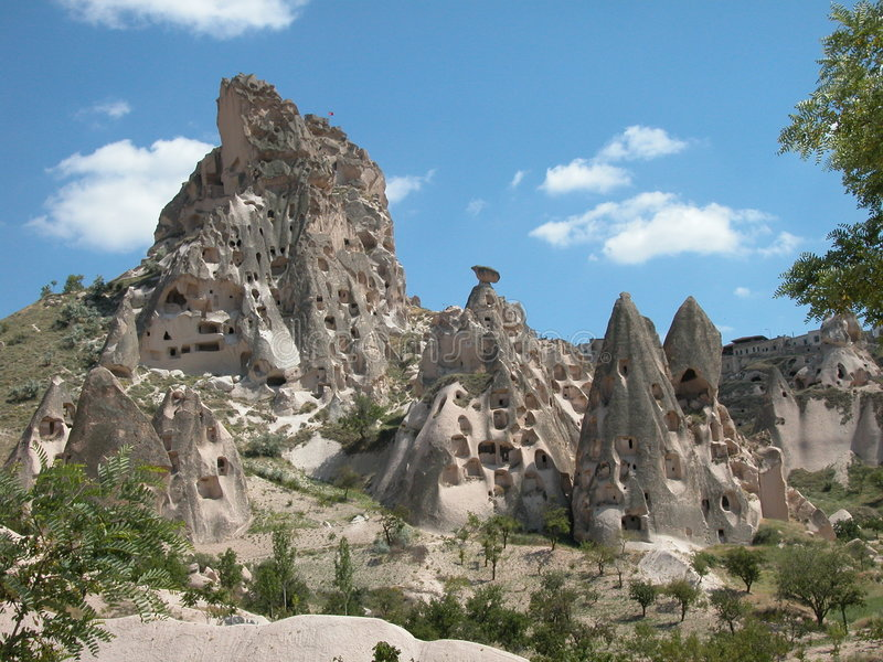 Rock dwellings. Cappadocia, Turkey. A small city of houses carved out of the natural rock formations at Cappadocia, Turkey royalty free stock photo