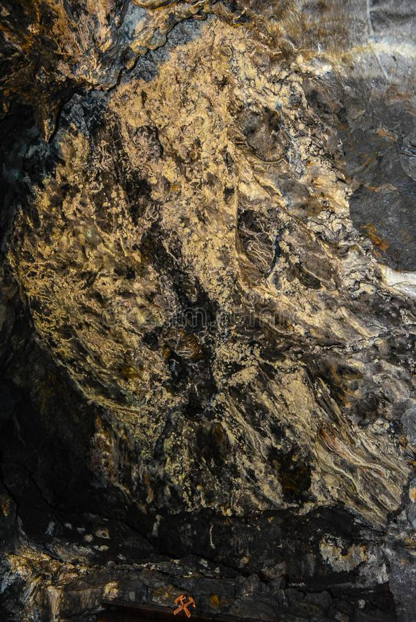 Rock face of a copper mine with a copper stock photos
