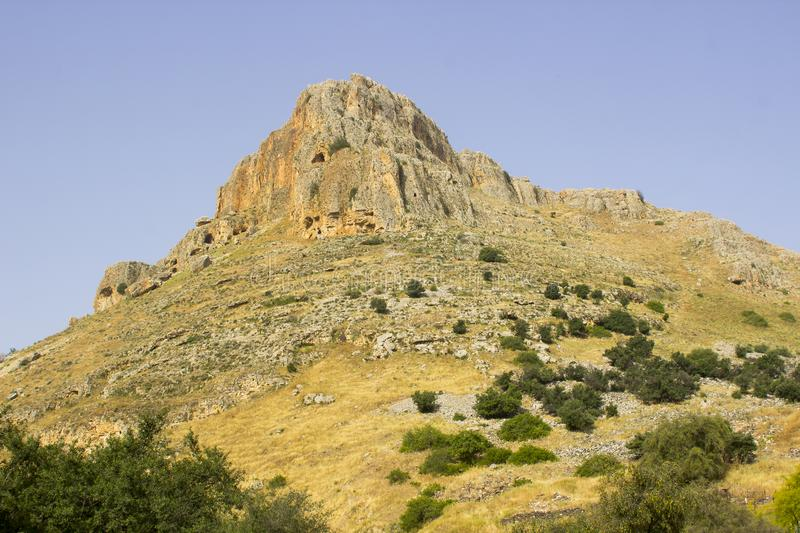 The rock face of mount Arbel n the Valley of The Doves in Israel royalty free stock photos