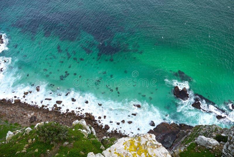 Rock face into the sea stock photography