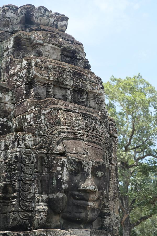 Rock faces in the temple of Bayon, Angkor, Cambodia. Big rock faces in Bayon temple, so beauiful and huge !!! 4 heads for one big statue. Buddhist temple in stock images
