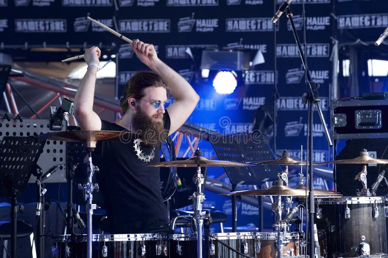 Rock festival. The drummer is a guy with a beard threw up his hands while playing the drums royalty free stock images