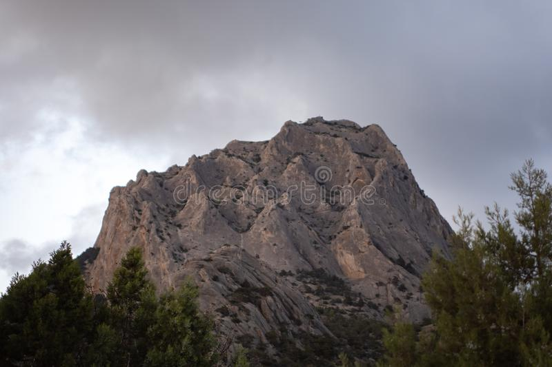 Rock in the form of a crown with clouds royalty free stock image