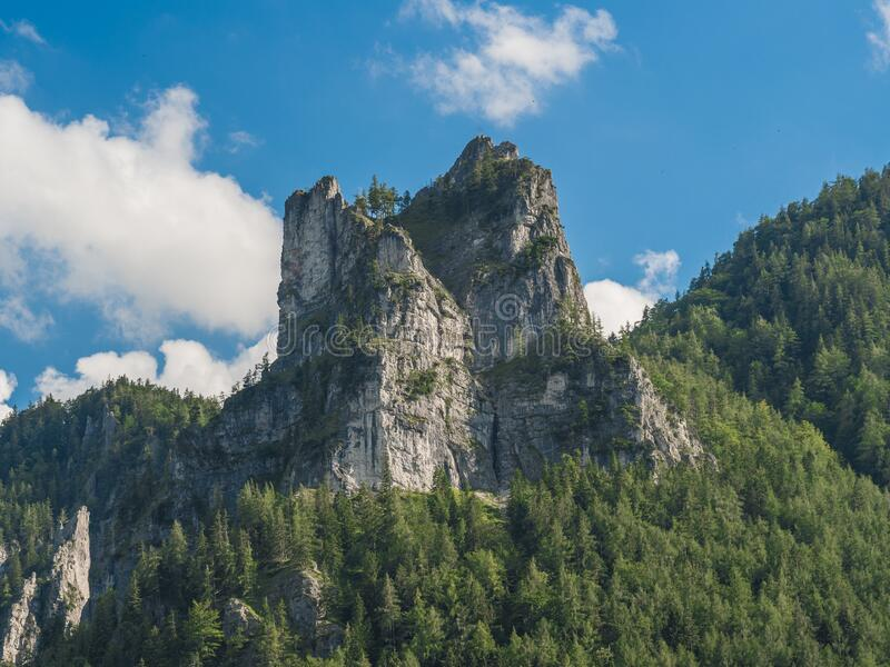 Rock Formation and blue sky with clouds. Rock Formation and forest and blue sky with clouds stock image