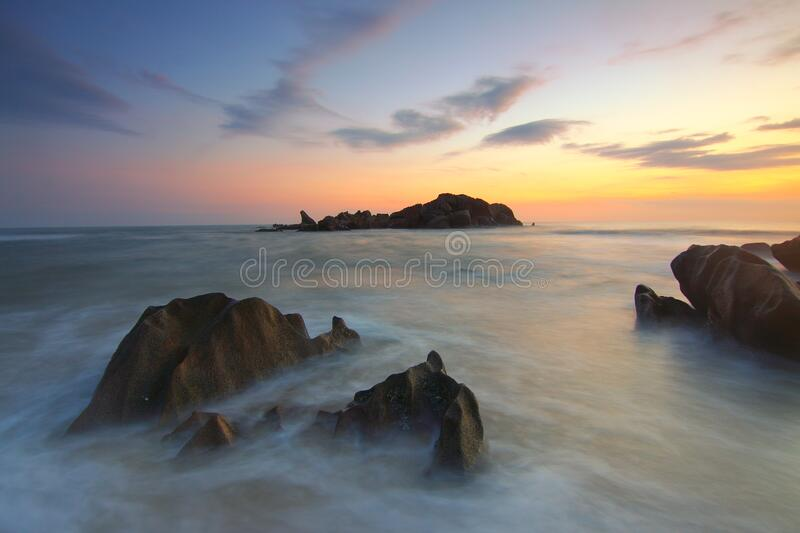 Rock Formation On Body Of Water During Golden Hour Free Public Domain Cc0 Image