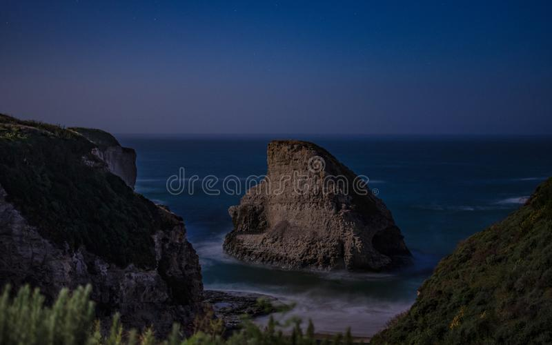 Rock Formation in the Middle of Body of Water royalty free stock photo