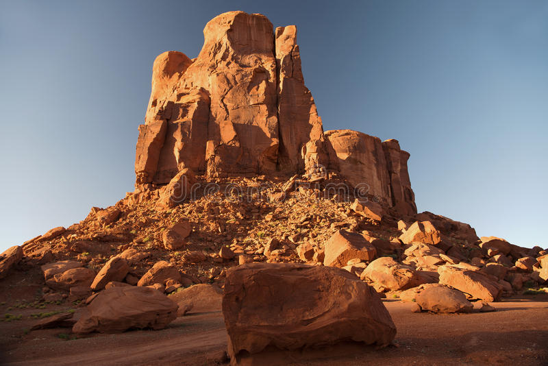 Rock Formation in Monument Valley Navajo Tribal Park. Sunset near the cube. Huge boulders cracked off this rock formation in Monument Valley Navajo Tribal Park royalty free stock image