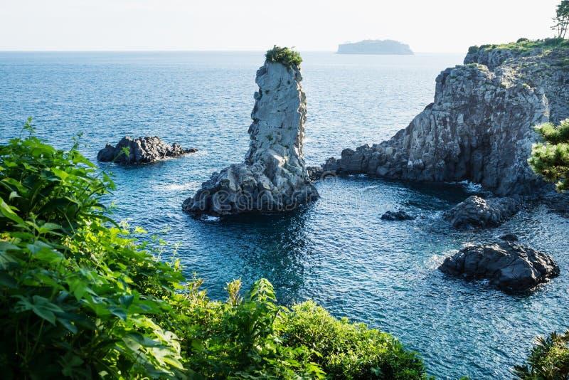 Rock formation Oedolgae in dark blue ocean at Seogwipo, Jeju Island, Korea royalty free stock photography