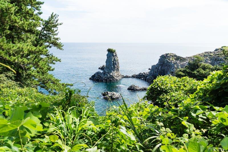 Rock formation Oedolgae in green halfcircle in the ocean at Seogwipo, Jeju Island, Korea royalty free stock image