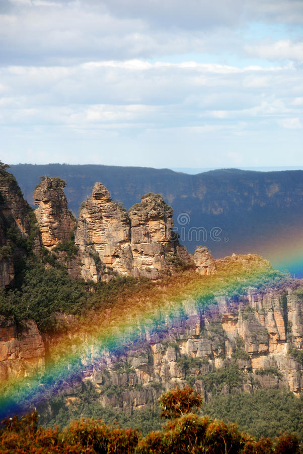 Rock formation with rainbow stock photo