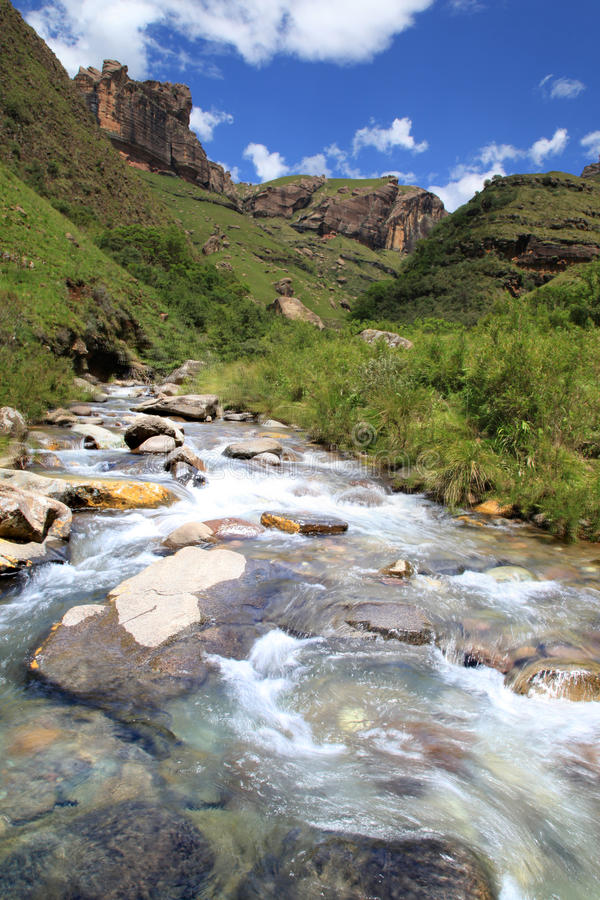 Rock formation and river. Clarens Sandstone rock formation. Geological feature in the Southern Drakensberg. Mountain stream stock images