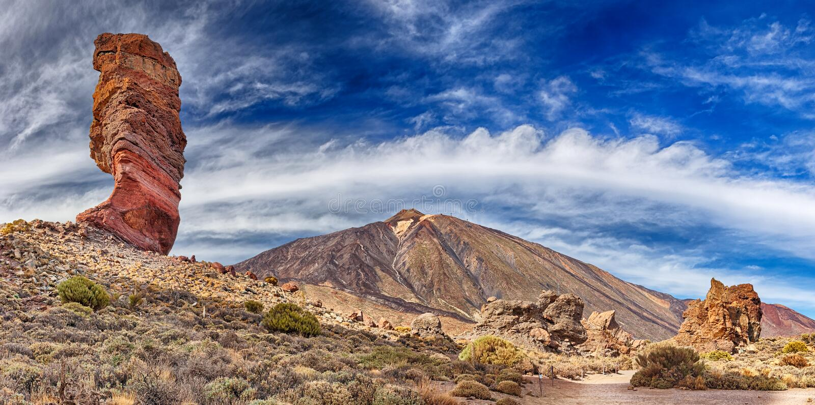 Rock formation Roque cinchado in front of volcano Teide Tenerife, Canary Islands. Panoramic view stock photography
