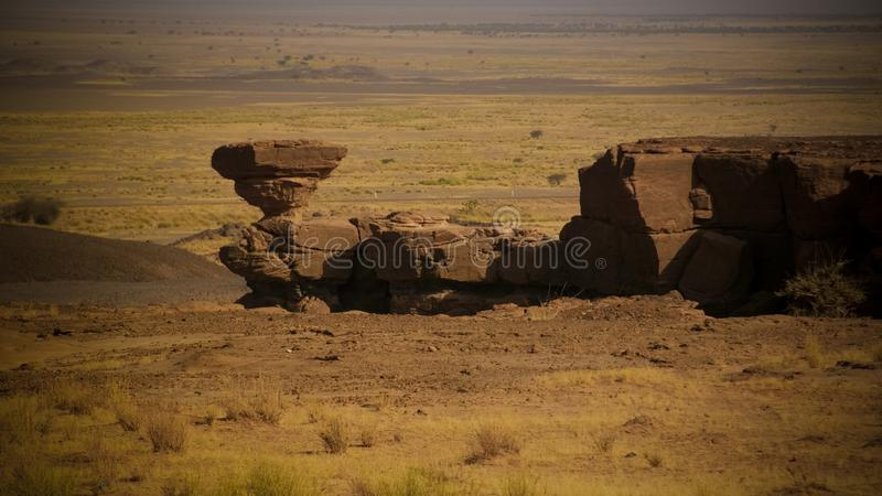 Rock formation at Sahara desert near Tchirozerine region, Agadez, Niger. Rock formation at Sahara desert near Tchirozerine region near Agadez, Niger royalty free stock photos