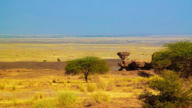 Rock formation at Sahara desert near Tchirozerine region, Agadez, Niger. Rock formation at Sahara desert near Tchirozerine region near Agadez, Niger stock photo