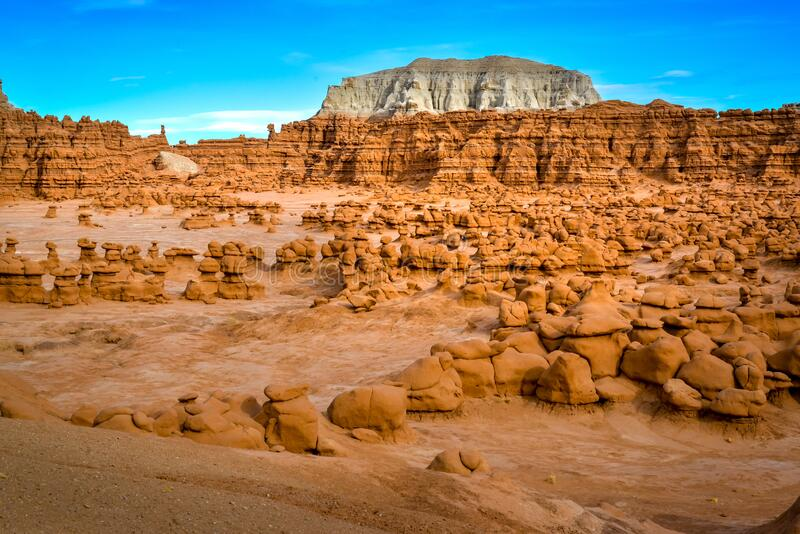 Rock formation in the shape of fairy chimneys at Goblin valley Utah USA. Geologic rock formation in the shape of fairy chimneys at Goblin valley Utah USA royalty free stock image
