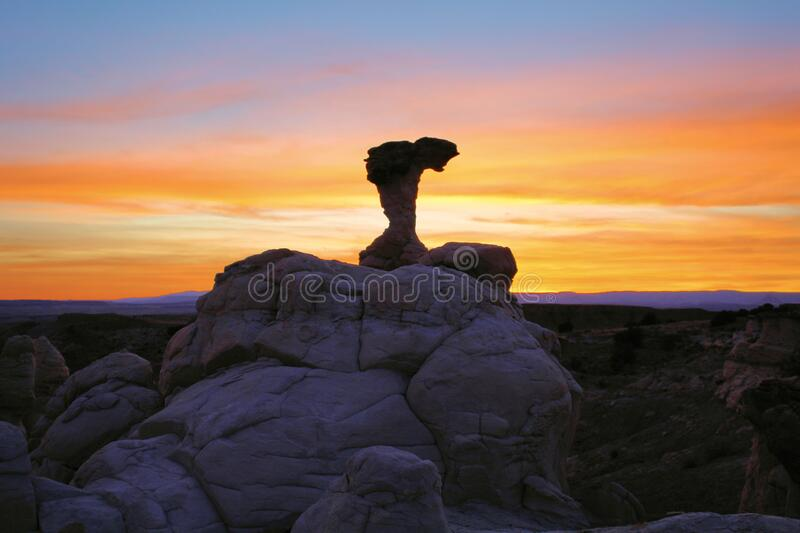 Rock Formation at Sunset. A desert rock formation backlit by a New Mexico sunset west of Albuquerque royalty free stock photos