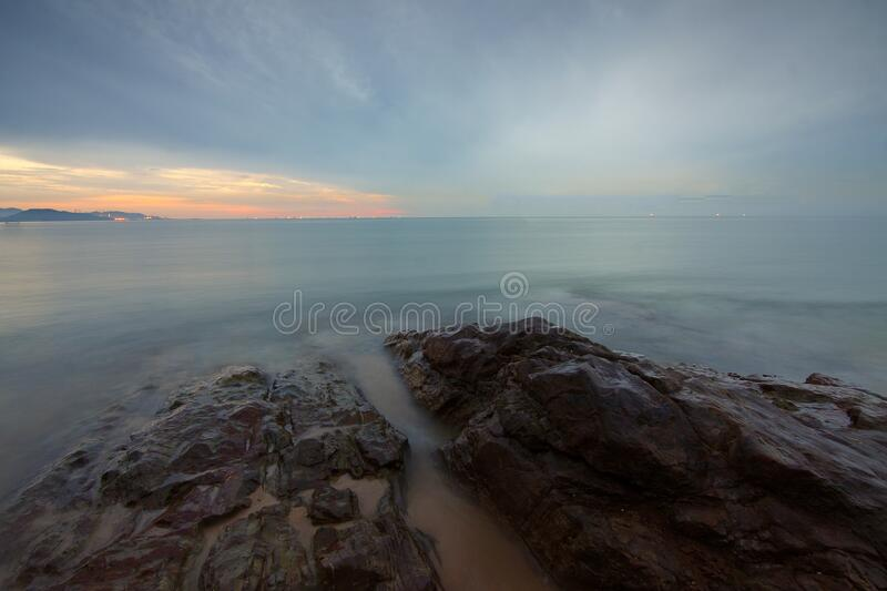 Rock Formation Surrounded by Sea during Daytime stock photos